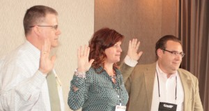 Photo of Dale Picha, Susan Langdon, and Kirk Houser being sworn in.